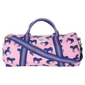 """Pack for an afternoon on the town, your morning tennis match, or a weekend trip with this preppy canvas bag, showcasing a chic horse motif.   Product: DuffelConstruction Material: Cotton and polyesterColor: Light pink and navyFeatures:  Fully linedDurable webbed shoulder and handle strapsChunky zip closure Dimensions: 11"""" H x 22"""" W x 11"""" DCleaning and Care: Spot clean"""