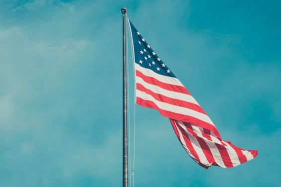 American flag fluttering in sky | Free Stock Photo