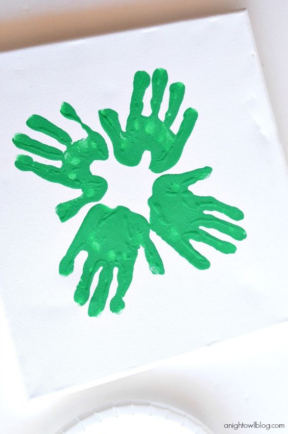 Fun for St. Patrick's Day! Make easy Handprint Clovers or Shamrocks with your little ones!