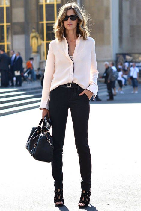 Amanda Brooks keeps it simple in a silk blouse and straight jeans.