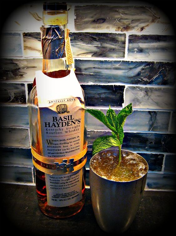 Mint Julep 2.5 ounces bourbon 1/2 ounce simple syrup or agave nectar handful of fresh mint leaves, plus one sprig dash of powdered sugar lots of ice, crushed if possible  In a silver cup or old fashioned glass of your choice, muddle your mint leaves and simple syrup. Then add bourbon. Fill with crushed ice and garnish with a mint sprig. Add a dash of powdered sugar. Drink immediately!