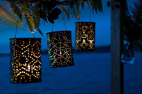#DIY lanterns. Fun reuse for old Coffee cans! Fun project for cubs to nail punch contellations into.
