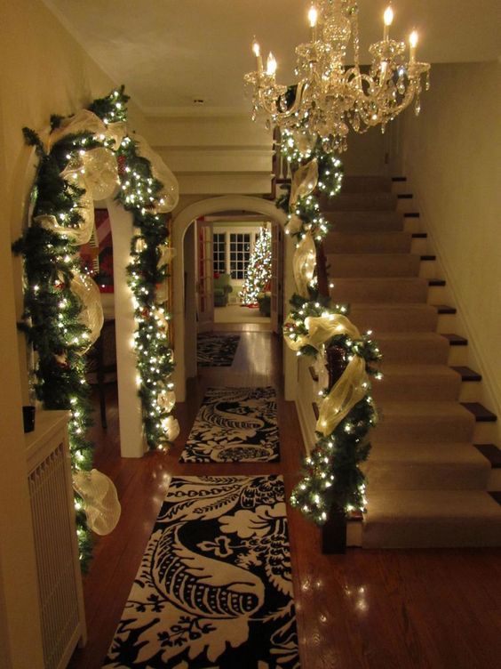 Foyer entrance Christmas lighted garland...I love everything about this pic. Except for the chandelier yuck: