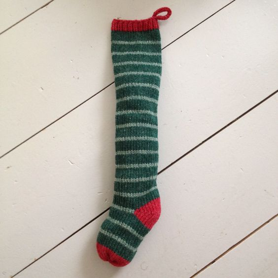 "Green Fairytale Stripes ~     A Swell Company tradition...Hand knit with cozy wool yarn from Maine sheep, our colorful Christmas stockings are ready to stuff with holiday goodies or hang in cheery profusion by your fireside. Bring the warmth of a rustic Maine farmhouse to your home for the holidays with our Farmhouse Stocking collection!    Length: 24""    Because each stocking is individually handmade, sizes may vary slightly.   Made in Maine. 100% wool. $35  Order online…"