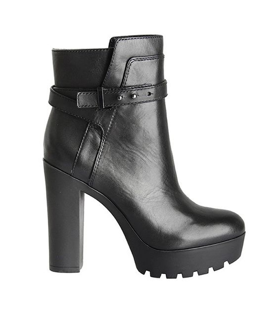 "Pour La Victoire's Emme in black is a beautifully structured lug sole platform bootie in polished calf leather with rounded toe and push ankle strap detail. 1"" platform, 4 ½"" heel. Leather."