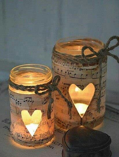 mason jar or glass candle holder, twine, and lemon stained music sheets