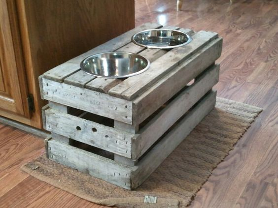 Mark just finished - raised dog feeder from old crate.  Variation of pinterest idea
