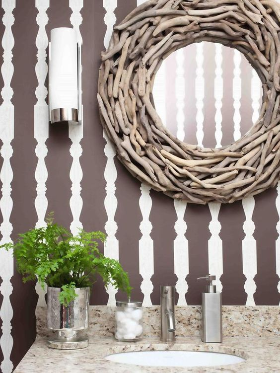 Love these porch spindle silhouette walls and the fabulous driftwood mirror! Organic meets graphic!