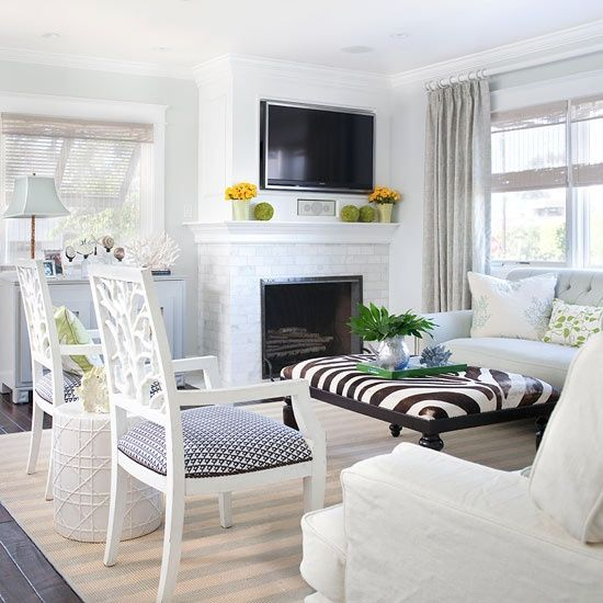 the furniture layout in this room is brilliant even the off center fireplace feels perfectly balanced living room