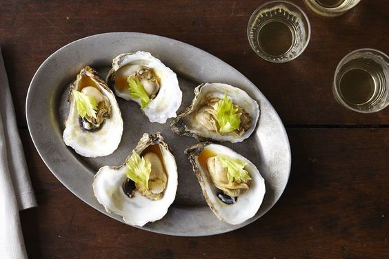Oysters with Caramelized Honey, Tomato Broth, Celery Leaves and Chili (W)