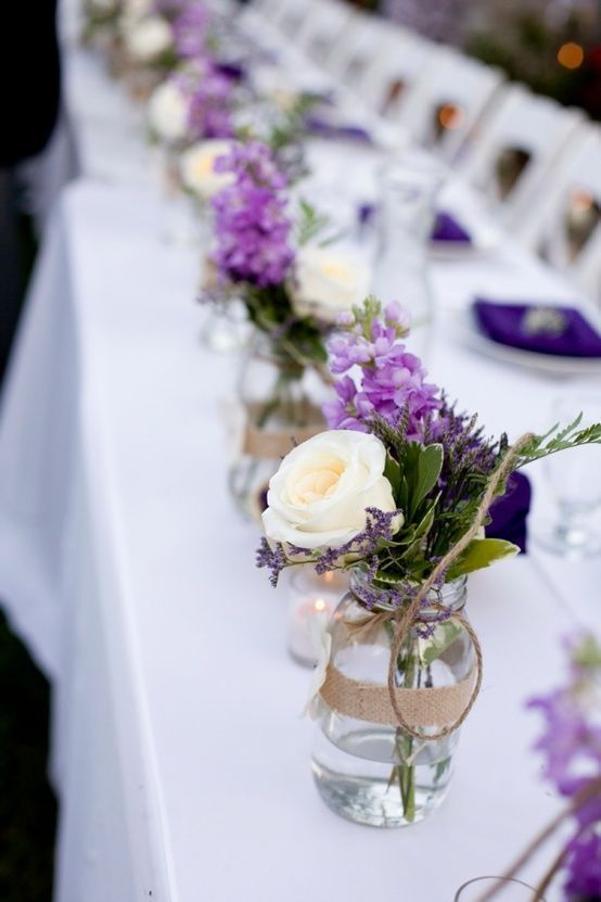 Purple rustic wedding centerpieces with mason jars and