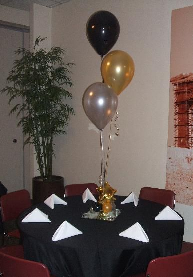 Black gold and silver balloon centerpiece pinterest