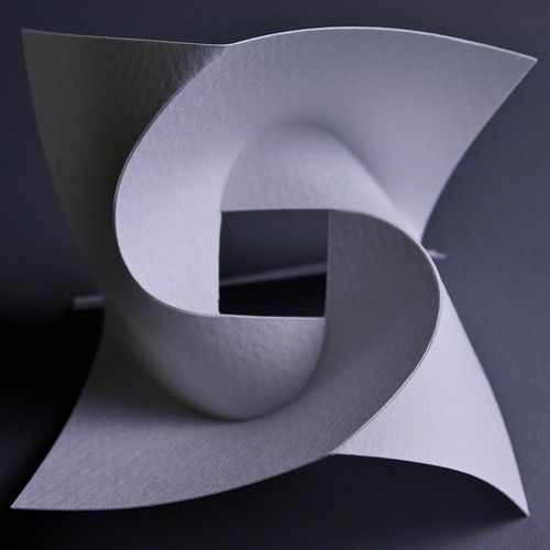 Curved folding construction techniques. If I make a big one, it could be a nice piece to hang on the wall.