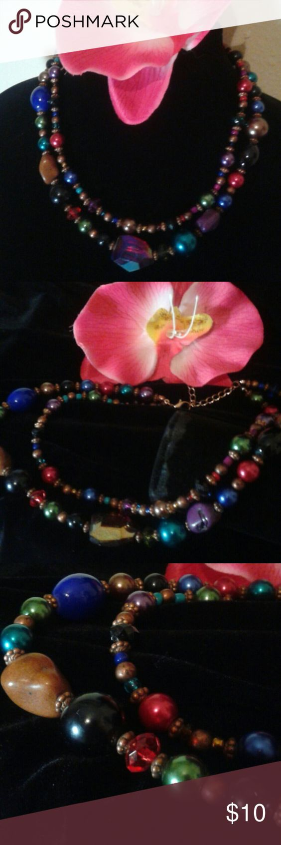 Charming Charlie double-stranded beaded necklace Multi-colored strand beaded necklace two strands with bronze accent clasp and chain medium length Charming Charlie Jewelry Necklaces