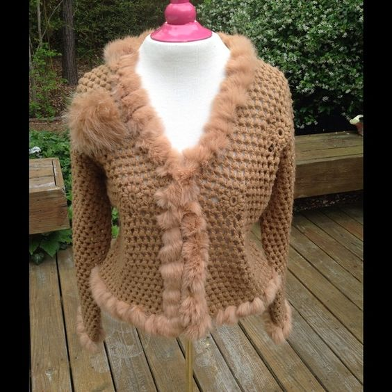 Butterscotch crochet sweater/jacket with fur trim. This is a great sweater! I love it! My age demands I reconsider though. ( hot flashes anyone? ) The trim is rabbit and so is the pin. But this does not appear to shed. Perfect condition and A GREAT LOOK! Cabo Sweaters