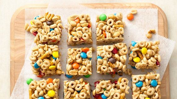 Sweet chocolate candies and salty peanuts and pretzels make these no-bake cereal bars the perfect snack.: