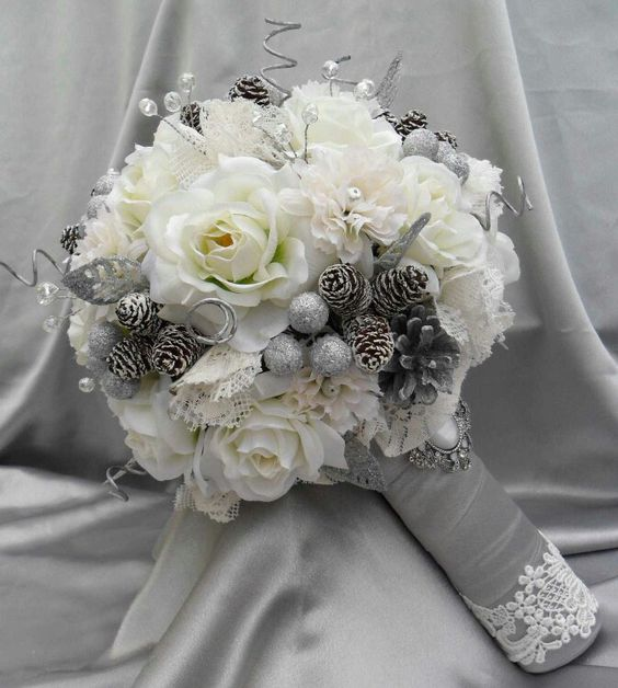 Winter wedding bouquet with miniature pine cones.