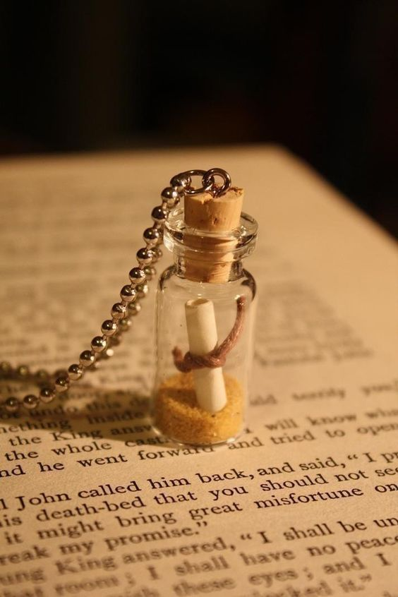 Glass Vial Necklace - I'm going to make one of these, with a little rolled up piece of paper with Lou's paw print on it