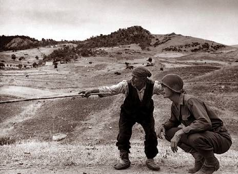 Amercian soldier with an Italian peasant. Sicily, 1943.