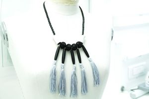 A unique macramé necklace from my winter collection with black cord (4mm),silver tassels and black wooden tubes.