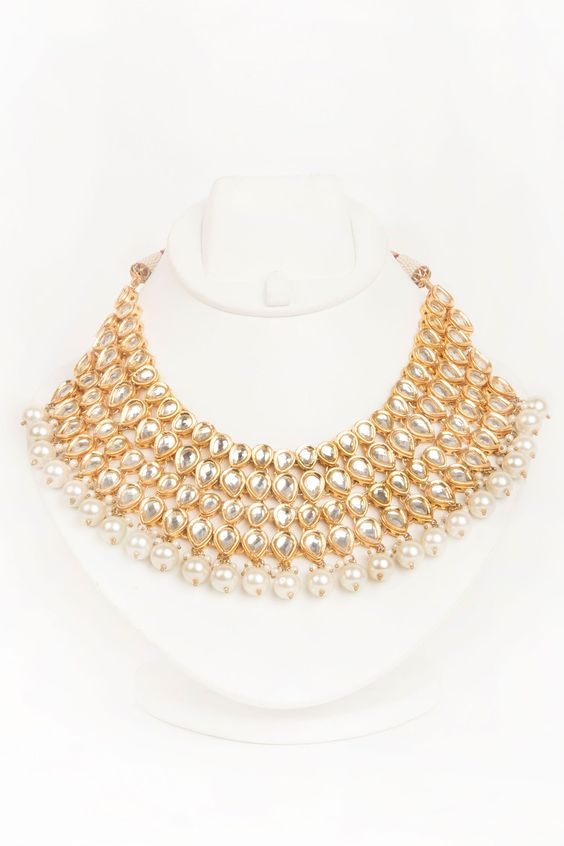 Four layered kundan neckpiece by Rever. Shop Now at…