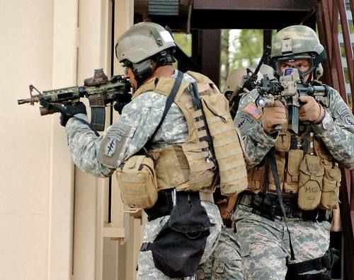 """Source: U.S. ARMY PHOTO, SGT. DANIEL LOVE, 7TH SFG(A) PAO/MARSOC  7th Special Forces Group (Airborne) soldiers move alongside each other during urban combat training at Fort Bragg, North Carolina. They are armed with the MK 18 carbine, a modified M4A1 with a shortened 10.3-inch barrel and fitted with a close quarters battle receiver (CQBR).  Marines speak their own language. Fred Pushies, author of MARSOC: U.S. Marine Corps Special Operations Command, shares a little """"Marine Speak."""""""