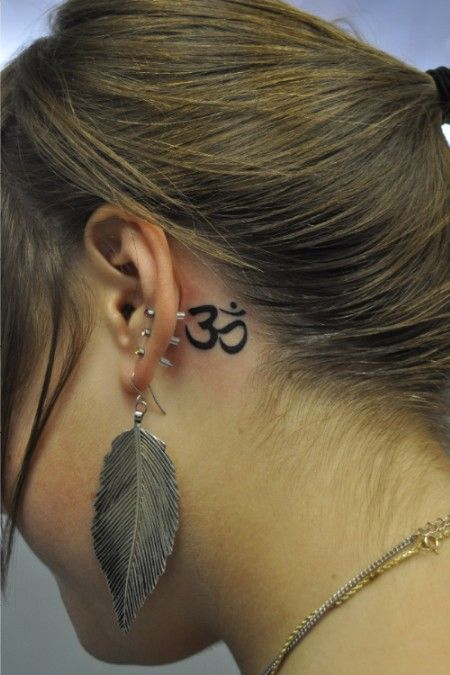 om ear tattoo