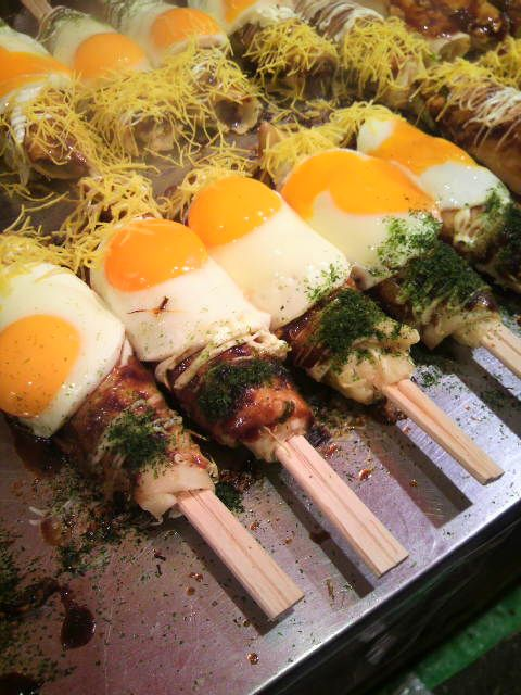 Japanese Okonomiyaki on Waribashi Chipsticks as Street Stall Foods (Osaka, Japan) chopstick in the center for serving.onto plate...looks fun