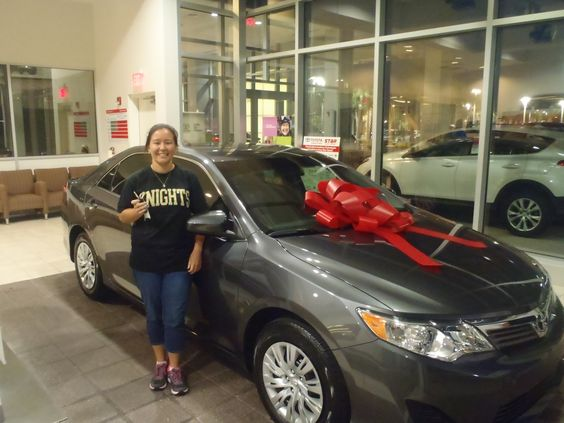 Evelyn with her shiny new 2013 #Camry -- Welcome to the #DavidMausToyota family! -- Love the red bow! #Toyota #WhateverItTakes