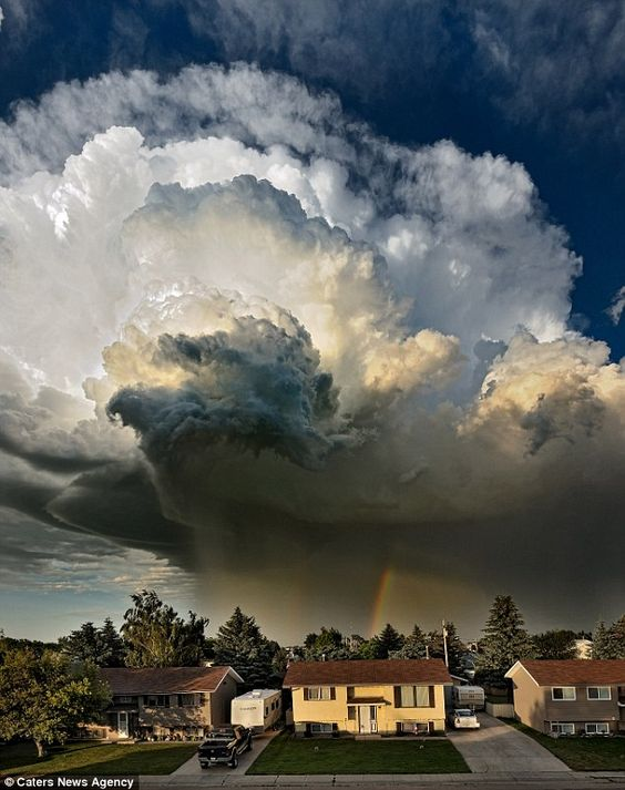 Pat Kavanagh took this shot of an explosive black storm from the roof of his house in Taber in Alberta, Canada