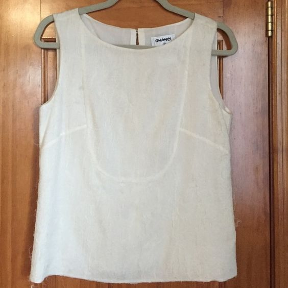 Chanel 100% Authentic silk sleeveless top Cream colored Chanel sleeveless silk top. pearl button closure at back of neck with CC detail. Never worn, no tags. Size 38 CHANEL Tops Blouses