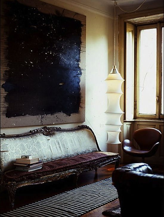 Dark living room with art. #painting #astract #cozy