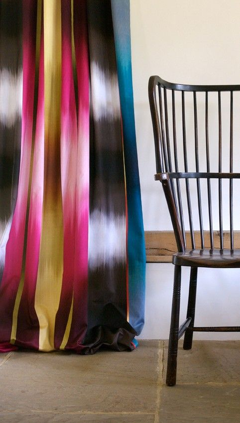 Colorful modern ombre drapery panel juxtaposed against a simple Windsor chair