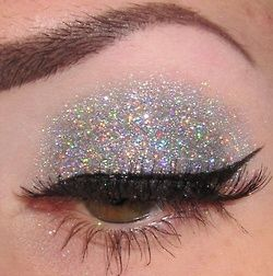 First apply a fresh coat of eye primer and tap the glitter shadow into place with a brush.  Then apply liner and lashes.