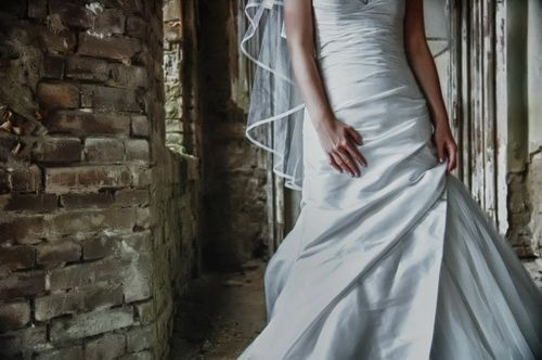 Nice contrast between the smooth, flowing wedding dress and the rough stones #wedding #photography