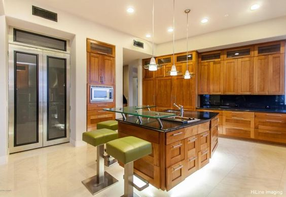 This Chef's kitchen featuring state of the art appliances, sumptuous cherry wood cabintery with designer under cabinet lighting and black granite & glass countertop. Its also owned by SF Giants pitcher ace Tim Lincecum and he is selling his party pad just shy of $4 Million.