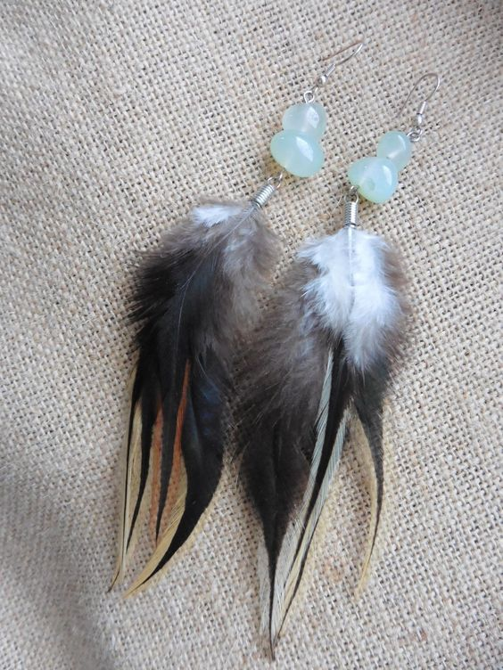 ☆  Feather earrings made with green prehnite gemstones.