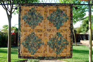 Tropical Batiks sew into log cabins.  Very rich colors.  The back is a deep seafoam color in fleece.