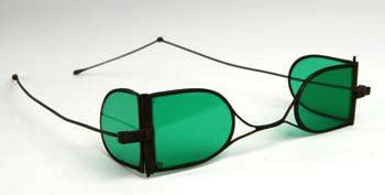 SYPHILIS GLASSES: Also from onegoodeye, is a rare set of green tinted four-lens spectacles commonly worn by sufferers of syphilis in the early 19th century. The design was patented by J.R. Richardson in 1797 and these 'double D' frames were hand made somewhere between 1800 and 1820.