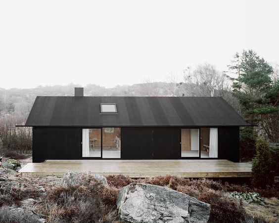 """House Morran by Johannes Norlander, Gothenburg Archipelago , Sweden (2010) """"The new facade is cladded in plywood, coated in black pine tar just like the traditional way of preserving wooden boats."""""""