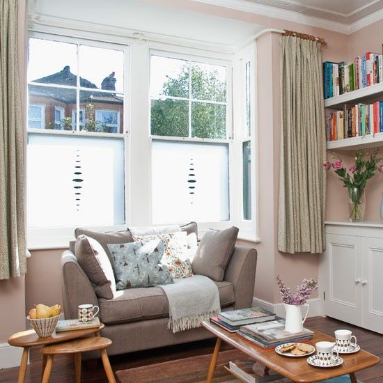 I like the use of etching on the windows rather than nets, so there's plenty of light but still privacy.  The colours are restful and this is a cosy look combining period features with some 50s retro style pieces. Nice and understated and not too difficult to achieve.
