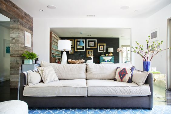 You'll Envy This Effortlessly Cool Family Home // blue rug, white Moroccan pouf, gold end table