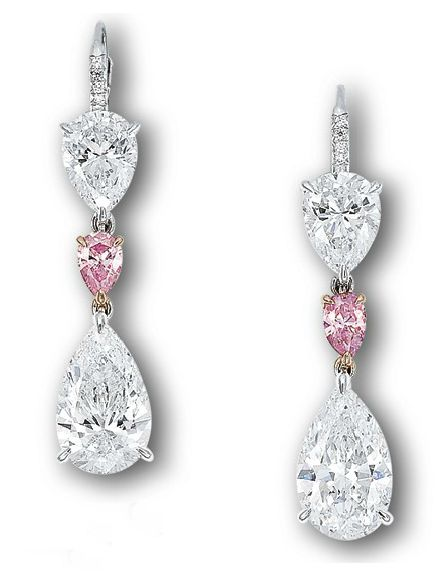 A PAIR OF DIAMOND AND COLOURED DIAMOND EAR PENDANTS   Each suspending a pear-shaped diamond weighing 3.13 and 3.01 carats, joined to a pear-shaped pink diamond spacer, to the pear-shaped diamond surmount weighing 1.54 and 1.53 carats, mounted in 18k white and rose gold, 4.0 cm long