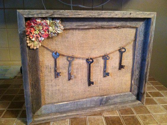 Empty frame, burlap, twine and old skeleton keys.  Embellished with paper flowers.:)