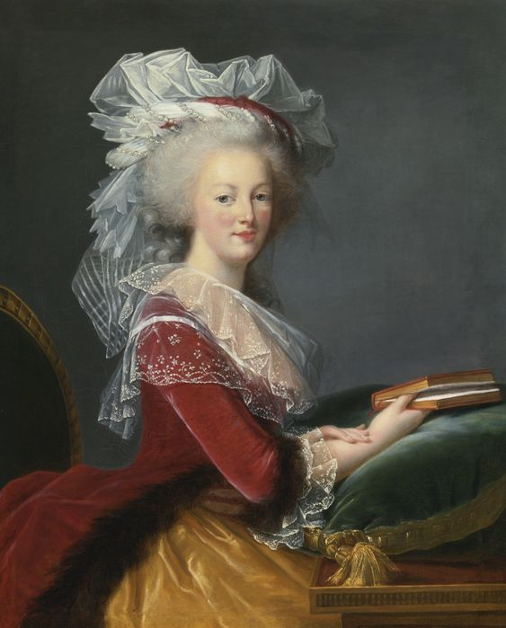 Portrait of Queen Marie-Antoinette, half length, wearing an elaborate silk-gauze cap, seated at a desk with a book in hand. Studio of Elisabeth-Louise Vigée Le Brun, Sotheby's