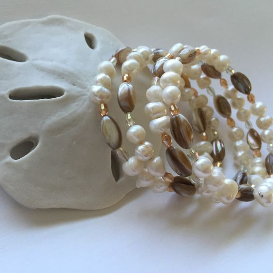 Wrap beaded bracelet White 6mm fresh water pearls Natural shell rice beads  With accents of Amber and clear glass beads This bracelet will go with anything Very comfy to wear, esp for those who don't like clasps This can be worn dressed up or casual.