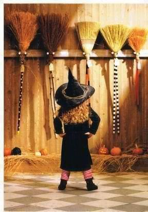 Halloween-Child Witch choosing her 1st broomstick
