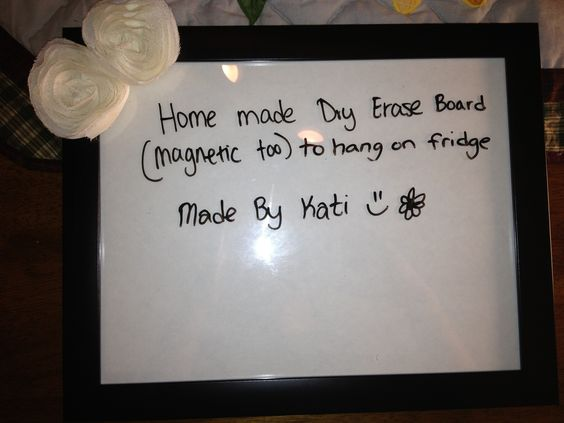 Home made dry erase board made by me(Kati Colson)   All you need is a picture frame, magnets(if u wanna hang it on the fridge), a bow, and hot glue gun:)