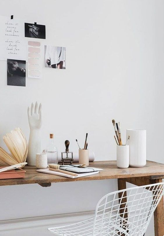 white walls and ceramics in artist desk area. / sfgirlbybay