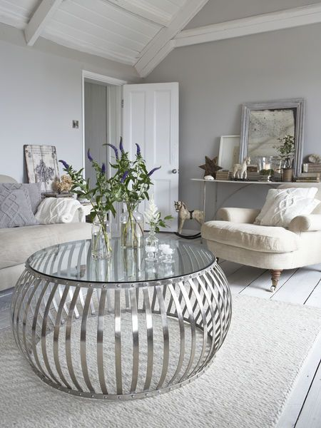 Sourced In Sweden, this fabulous riveted, barrel-shaped metal coffee table with a solid glass top is a stunning addition to any living room.